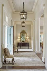 front entrance lighting ideas. elegant neutral entrance ~ ana rosa // cream and white home front lighting ideas