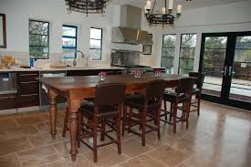 rustic kitchen island table with 7 counter height chairs with leather slipcover