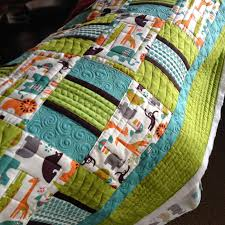 Urban Quiltworks: Straight line quilting and Channel Locks & This quilt is just so cute. I love the colours - so different. I used a  combination of spirals, straight lines and wishbone quilting in the teal  and green ... Adamdwight.com