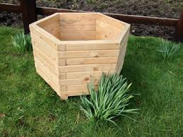garden items. Hexagon Wooden Planter Is Handmade, Very Strong And Good Quality. Made From Solid Pine Timber That Has Been Painted With Natural Oak Decking Oil. Garden Items