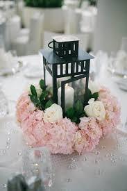 black lantern and pink flowers wedding centerpieces