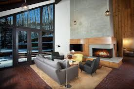 raised fireplace hearth living room contemporary with gray armchair novelty print decorative pillows
