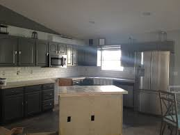Dark Kitchen Cabinets With White Subway Tile Backsplash