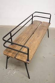 Panka - Indoor/ outdoor bench Panka is a handmade, made to order bench ,  built with reclaimed wood and recycled steel pipes, hand bent with  oxygen/acetylene ...