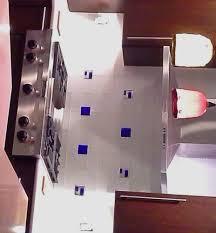 glass mosaic accent tile in cobalt blue dichroic glass inset into white subway tile kitchen backsplash