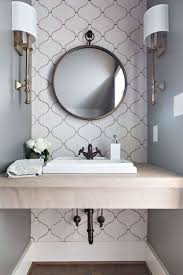 powder room wall tile designs. powder room love. arabesque tiles, limestone tops, kohler kathryn sink, brass, wall tile designs w