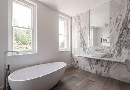 White marble slab bathroom with contemporary freestanding bathtub