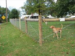 building a wire fence on uneven ground round designs