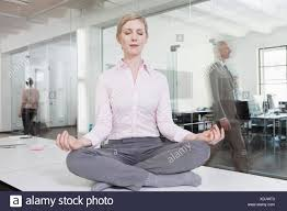 meditation office. Germany, Munich, Businesswoman In Office, Meditating On Desk - Stock Image Meditation Office E