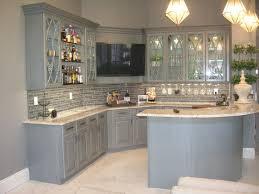gray kitchen cabinets. soapstone countertops light gray kitchen cabinets lighting flooring sink faucet island backsplash pattern tile stone mahogany wood driftwood amesbury door