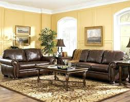 area rugs with brown leather furniture rediscovering the by brown leather sofas yellow living room wall idea plus traditional brown leather sofa and