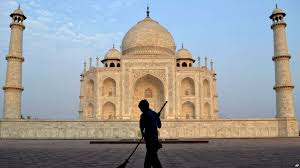 s taj mahal has insect problem file in this 3 2013 photo a worker sweeps in front