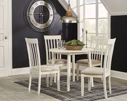 Slannery White Round Drop Leaf Dining Room Set 1stopbedrooms