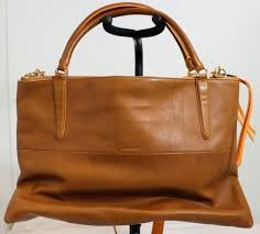 coach large borough edge paint leather purse how to get off my