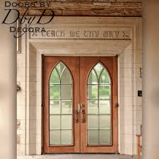 this pair of gothic arch doors add a touch of class to this rectangular opening