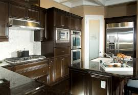 dark cabinet kitchen designs. Chocolate Brown Wood Cabinetry Surrounds White Tile Backsplash Over Dark Floors Inside Cozy Kitchen With Cabinet Designs