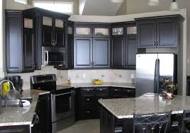 image of black kitchen cabinets with white countertops