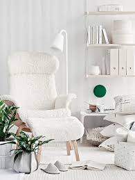 adorable white scandinavian living space idea with vertical stripe  patterned wall and wall bookshelves and white  awesome white for cozy  reading chair ...