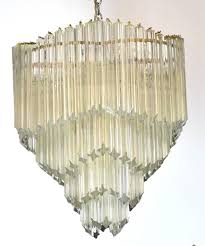 a mid century modern chandelier with four tiers of venini murano crystal triedre prisms
