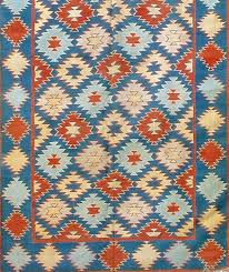 dhurries are the quintessential indian flat weave woven with cotton they are lightweight