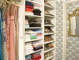 good closet design ideas with white shelves and unique wall mirror design