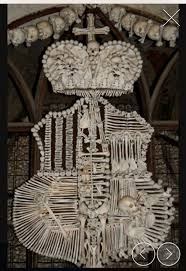 two bone monstrances a vessel used to display the eucharistic host a family crest in you guessed it bone and skull candle holders
