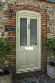 kingston entrance door in a colour complementary to farrow ball old white featuring etched sun glass panels polished chrome escutcheon townhouse