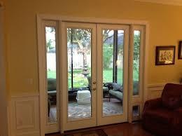 glass exterior door with pet door. french door with sidelites and pet door. this was a sliding glass unit. exterior