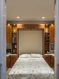 custom bed surround wall unit shelving with integrated desk