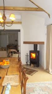 contura 51l wood burning stove in neat corner fireplace made possible by using twinwall fluepipe