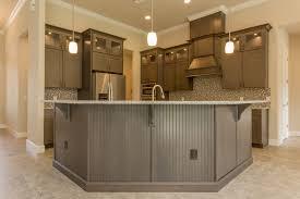 walnut wood grey amesbury door kitchen cabinets melbourne fl backsplash shaped tile stainless teel travertine countertops