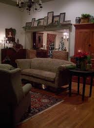 Primitive Decor Living Room Primitive Living Room With Open Shelving And Armoire And Wall Art