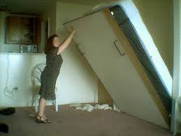 a person operating a murphy bed author david boyle cc by 2 0