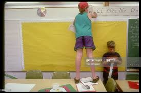 Students Douglas Arnold & Nate Carlson taking letters off wall on... News  Photo - Getty Images
