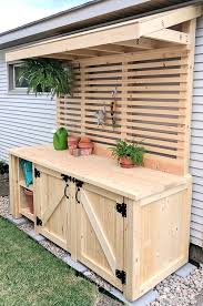 lots of photos and instruction for this outdoor potting bench i can t imagine this being easy to move so choose your location carefully
