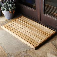 Welcome this beautiful, sustainably forested teak mat for its modern  attitude, eco-friendliness, and weather-resistancethen consider that its  raised, ...