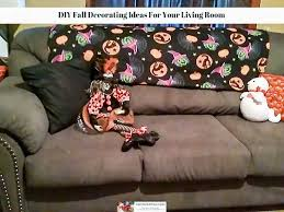 a couch with pillows plush animals and a throw on the back