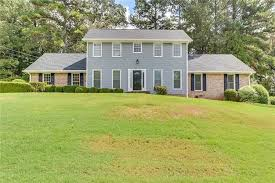 this stone mountain two story offers granite kitchen countertops hardwood flooring a tankless