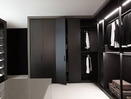 fancy walk in closet with mirror wood floor