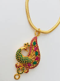 absolutely stunning peacock pendant gold necklace in stunning red and green high quality stones and flaunt it
