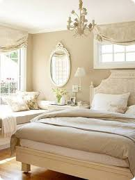 Tan Bedroom Neutral Bedroom Colors With Tan Walls And Small Chandelier And Bed