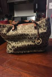 how to clean a michael kors purse