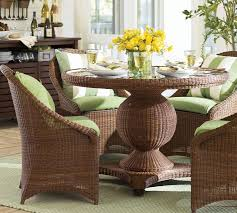 palmetto all weather wicker round pedestal dining table chair set honey pottery barn