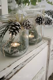 Candles, greenery and frosted pinecones can be used for Christmas and winter  decor!  