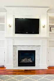 granite look alike painting tile around black frame see through ventless gas fireplace design with white fireplace mantel and wall mounted flat screen tv