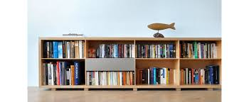 ... An Error Occurred Low Bookcase Two Shelves With Many Slots For Books  And Some Modern Decoration