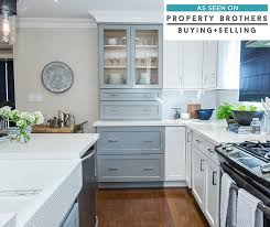Blue and white kitchen cabinets in Leeton door style