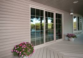 3 lite sliding patio vinyl replacement door with colonial grid pattern view from outside porch