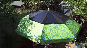 it can easily fit onto a beach umbrella solarbrella fold away solar panel