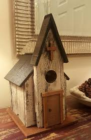 Rustic Church birdhouse made of pallet wood and scraps laying around  garage. I love it